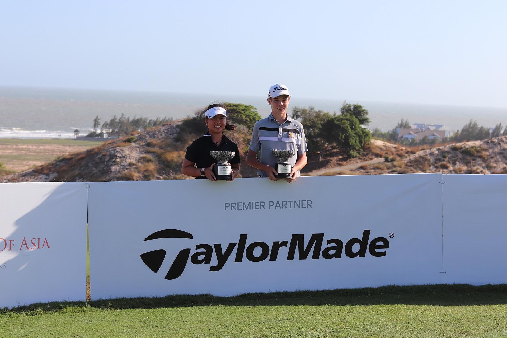 Junior Aspirations at The Bluffs Champions posing behind TaylorMade Signage, Premier Partner of the JGTA
