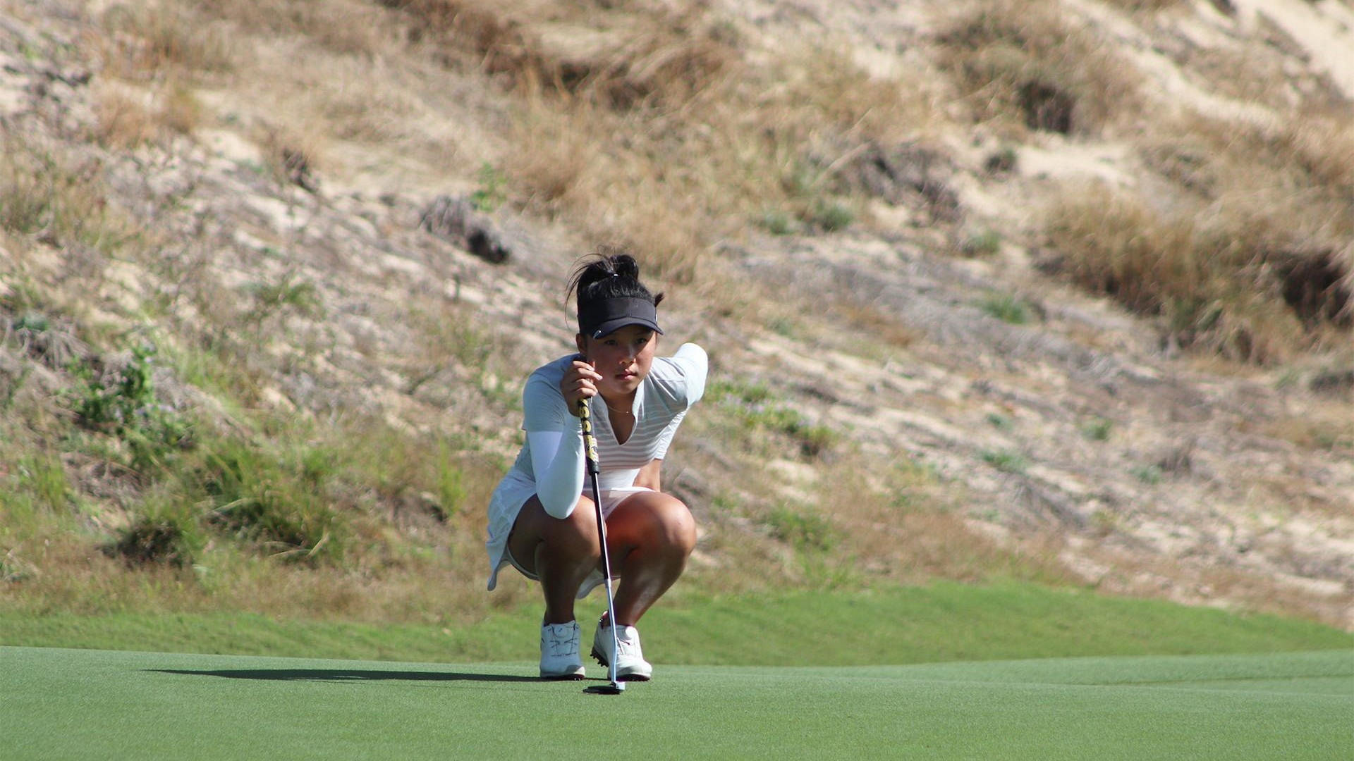 Yu Wen Lu reading her putt at the JGTA Junior Aspirations at The Bluffs, one of the many players from the JGTA leading the charge in the fight against Covid-19